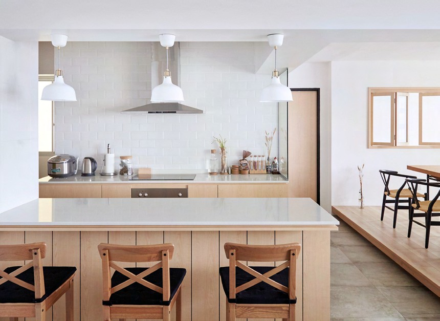 A light wood and white palette gives the kitchen a clutter-free look.