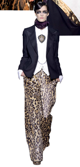 Take a bold stride in a tuxedo jacket and leopard print palazzo trousers