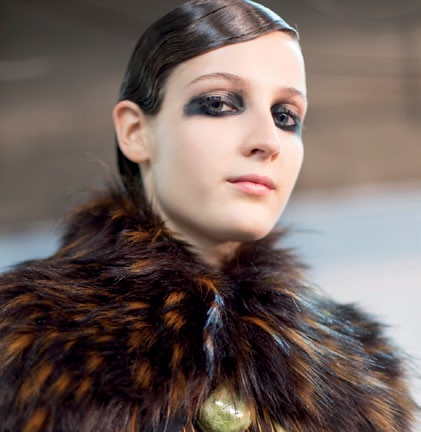 A fluffy fur collar sets off a pale winter face beautifully