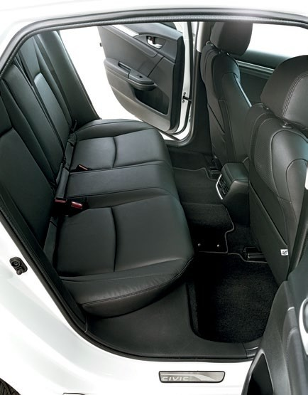 Plenty of footwell space for occupants to park their  feet, but the  high-ish floor protrusion makes it awkward for the centre passenger.