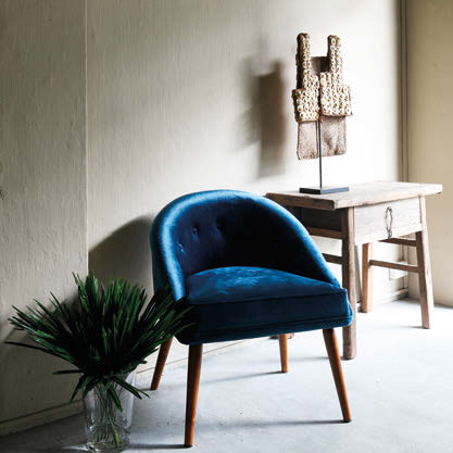 "Chair ""His"" in blue velvet is just one of the many styles Maud worked her magic on."