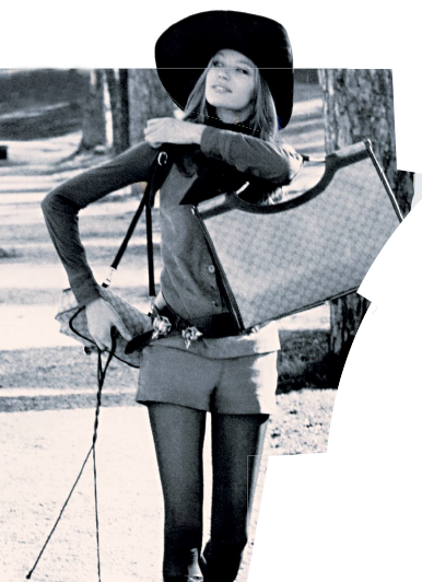 Veruschka on a stroll in Rome with dogs and bags in tow.
