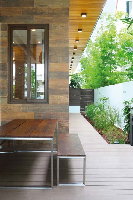 Wood accents on the exterior give the house a resort-like ambience.