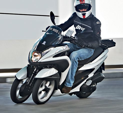 The Tricity is zippy in the city, comfy and more stable than a conventional 2B scooter.