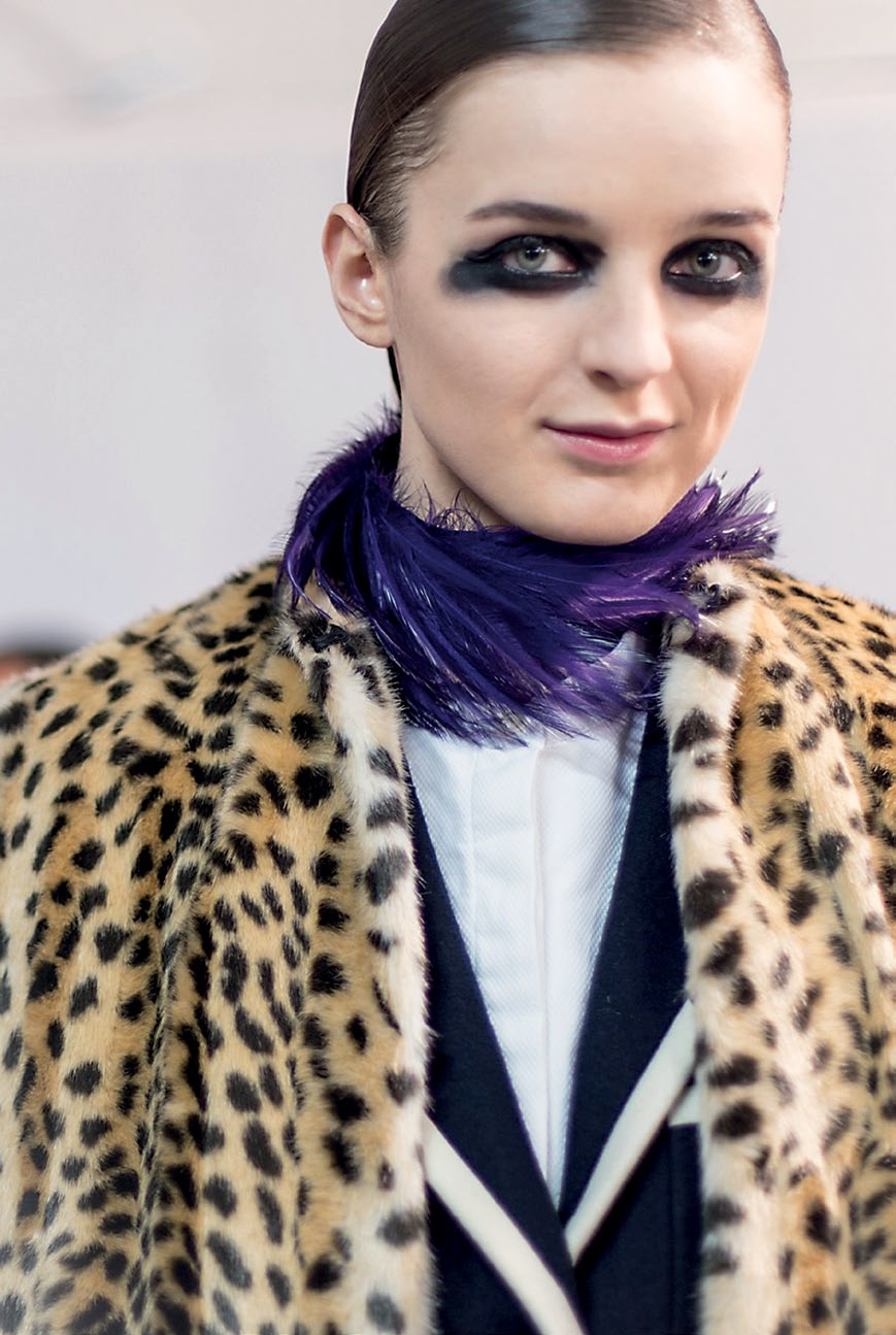 The cool mix of feathers against a fake leopard fur coat