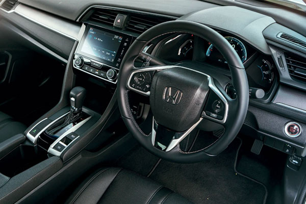 The buttons on the steering  wheel are intuitive, and the touch- sensitive volume  control works quite well.