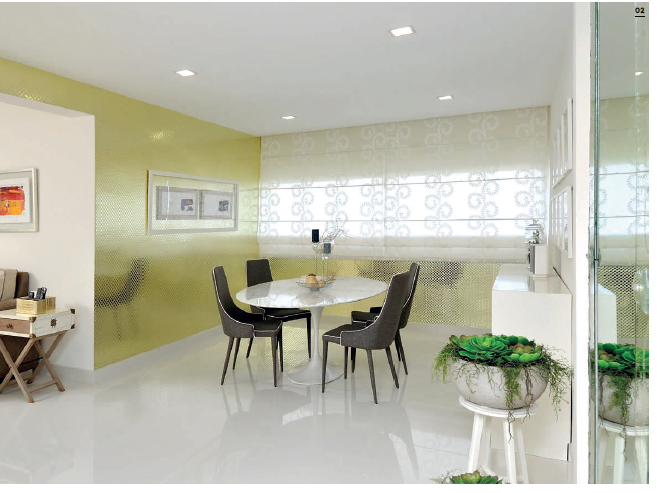 Reflective wallpaper adds a touch of luxury while enhancing the light-filled dining area.