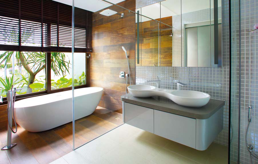 The naturally lit common bathroom has a resort-like look with a modern touch.