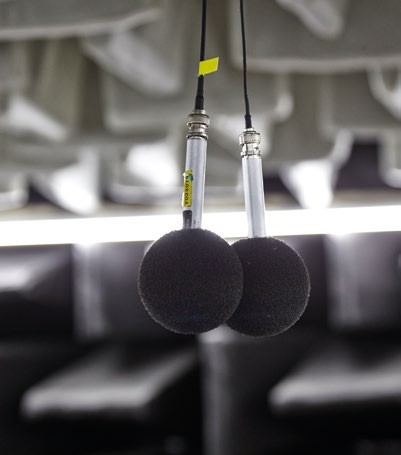 Microphones in a semi-anechoic chamber measure the sounds produced by Dyson products.
