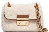 Michael Michael Kors shearling with leather trim, price unavailable.