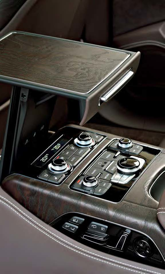 Rear-seat passengers in the Audi are pampered with video screens and a fold-out table