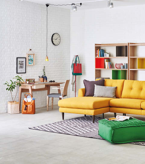 Inject a pop of colour into your home with the Haysel sofa, in cheery yellow.