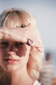 Elise Agee wears the chunky rings from Louis Vuitton's Cruise 2017 collection