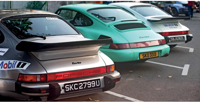 The 50 Porsches on this driveaway included five vintage 911s.