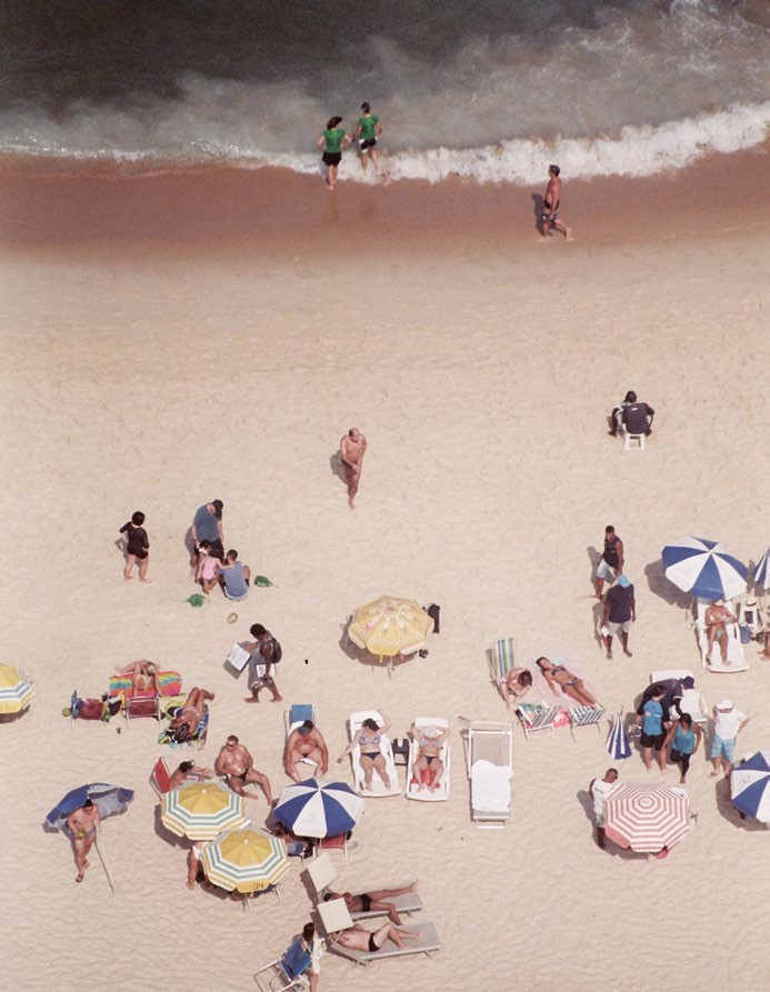 An aerial view of Ipanema beach. Tami Glauser in a cut-out dress-and-skirt combo that showcases Nicolas Ghesquière's playful take on youthful sexiness mixed with a sporty edge.