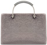 Faux fur, $75.90, from Charles & Keith.