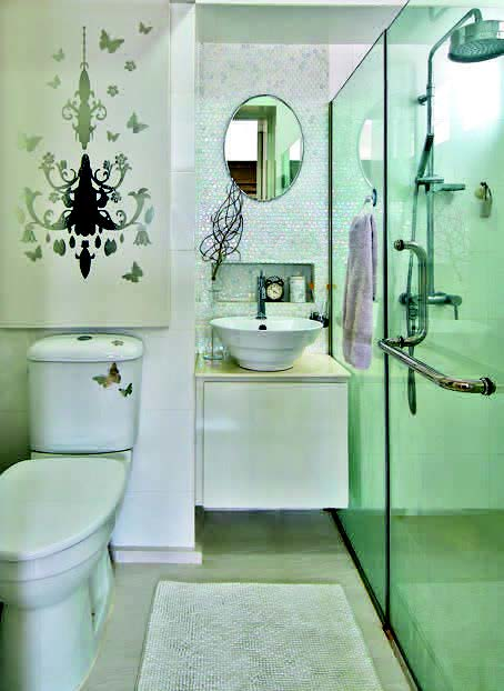 Luminous, shimmering and iridescent mosaic tiless add depth and texture to the master bathroom.