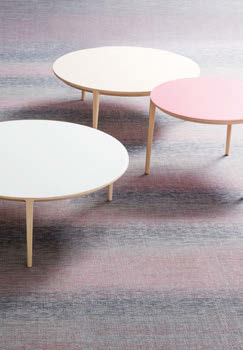 The three-legged Etoile tables are available in lightwood as well as pastel shades.