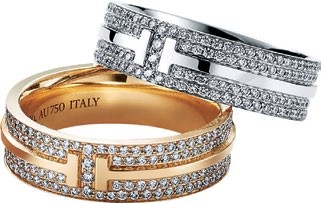 White gold and diamond  Tiffany T ring; gold and diamond  Tiffany T ring, Tiffany & Co.