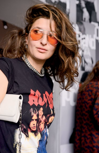 Retro shades and punk rock accessories give off a devil-maycare attitude