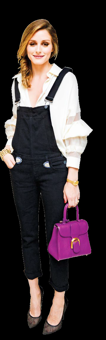 Olivia Palermo contrasts her overalls beautifully.