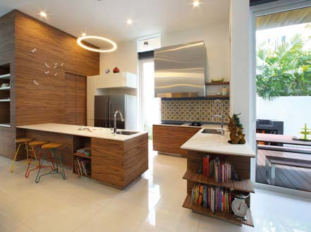 Intricate designs such as a Peranaken-tiled backsplash add character to the kitchen space.