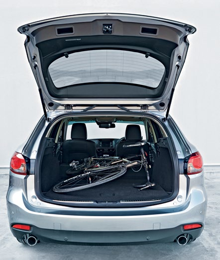 Thanks to its taller glasshouse, the Subaru (right and extreme right top) has the more airy cabin, though the Mazda's more cocooned interior (far right and extreme right bottom) lends it a greater sense of sportiness.