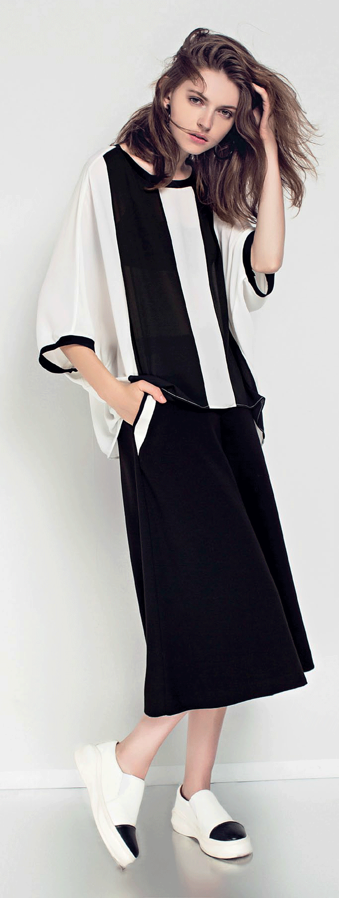 White silk blouse with black stripes, $209, Carattere.