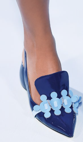 Whimsical details extend to Hindmarch's footwear off erings as well.