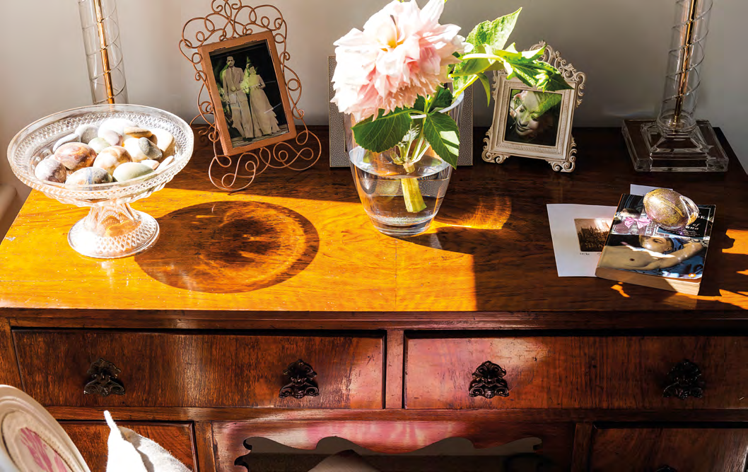 Treasured photos and knick-knacks are lovingly displayed on the study table.