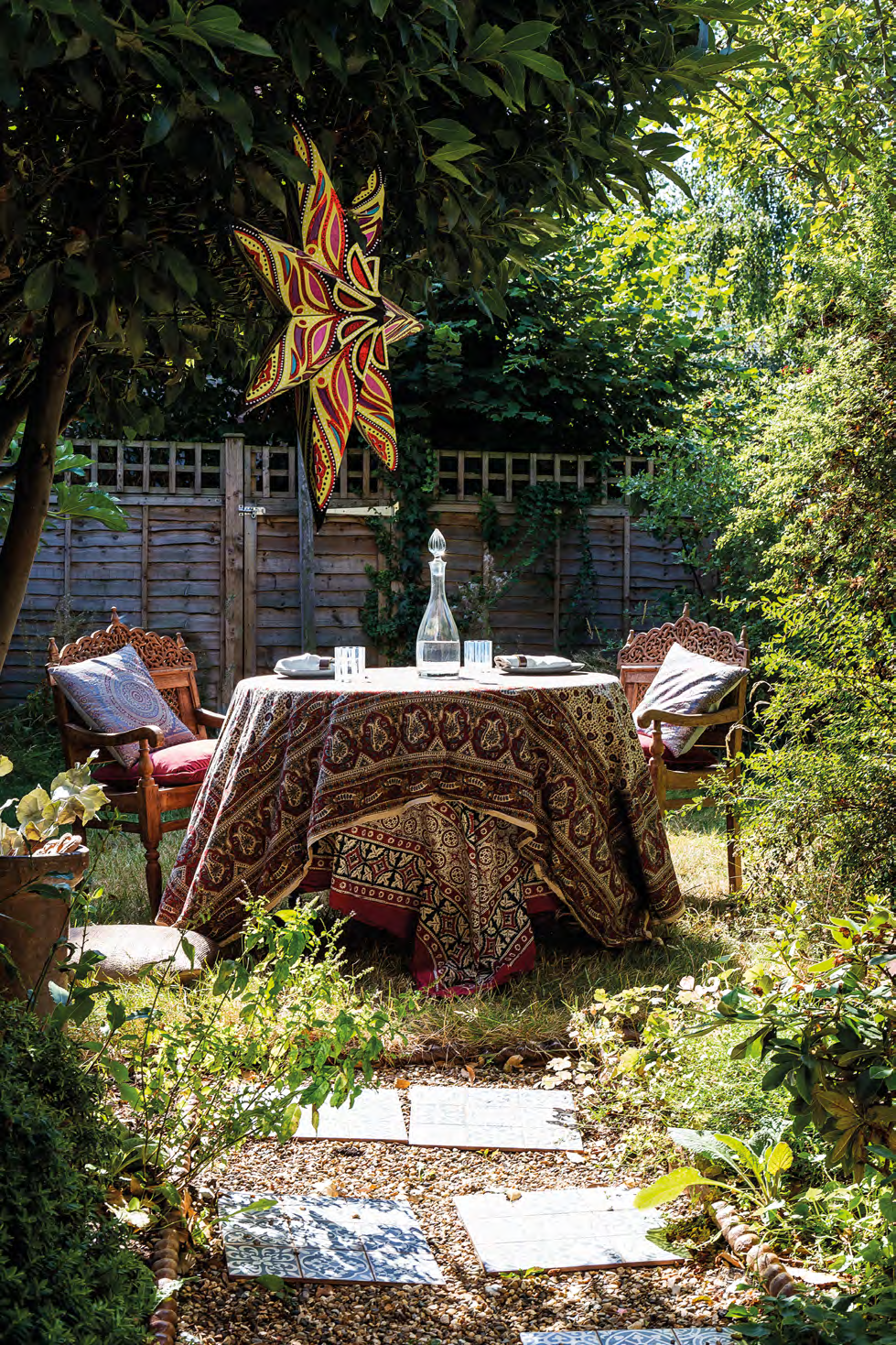 A pair of antique carved teak chairs from India complement the vintage textiles, which were hand-picked by Anouska's aunt when she was living in Mumbai.