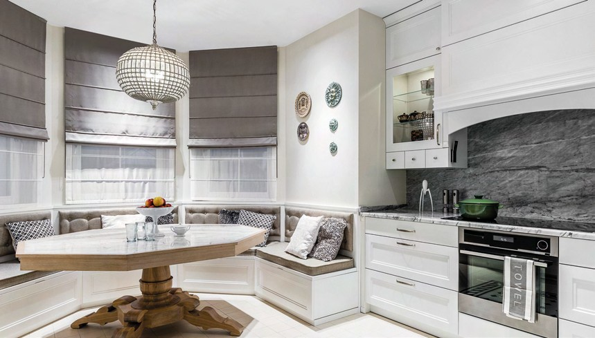 A marble backsplash becomes the highlight in the cooking area