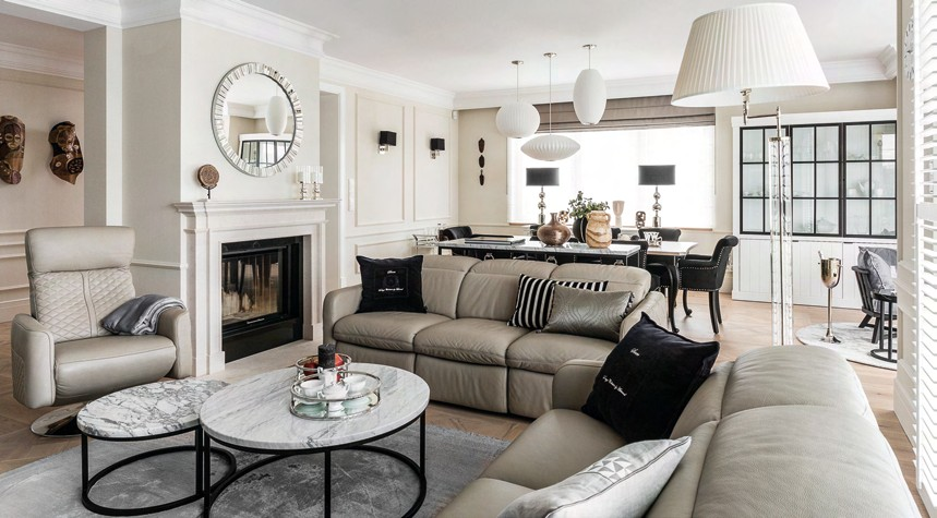 The neutral colour palette adds a sense of warmth and cosiness to the living room.