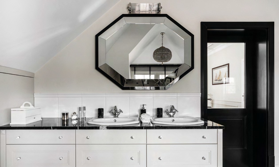 A luxurious  design in a classic style ties in the look of the master bathroom with the rest of the home.