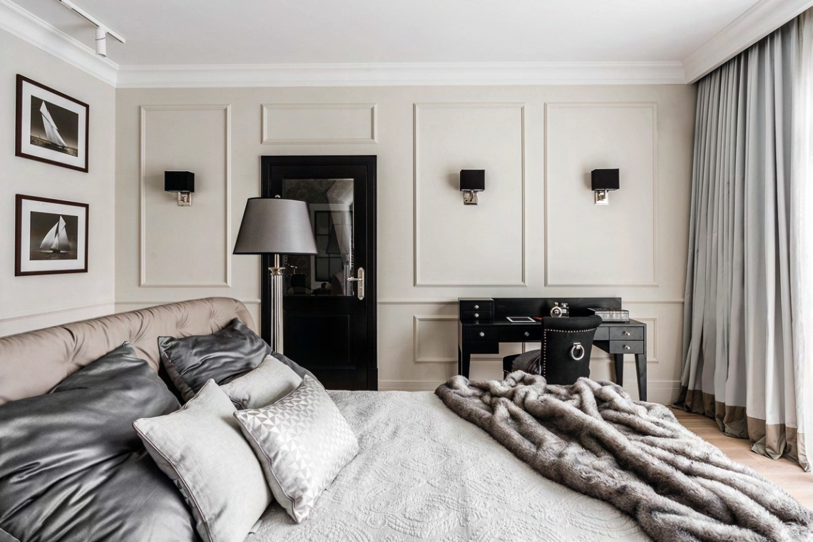 Delicate wainscoting gives depth to the bedroom.