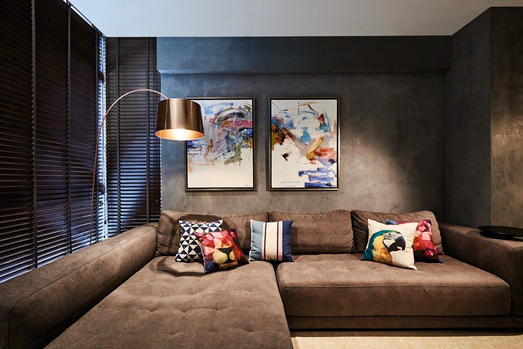 Instead of one large piece of art, Joey deliberately selected a pair of smaller paintings for the living room. They are hung off -centre to create visual interest, and the colours liven up the predominantly grey scheme.