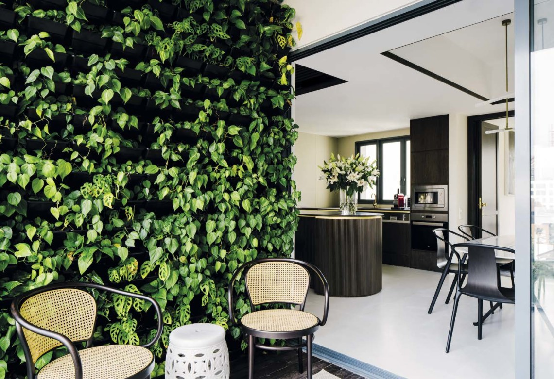 The balcony is Tommy's labour of love, as he had to personally integrate about 500 pots of plants into the green wall system.