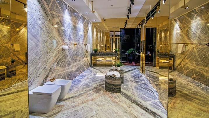 Elegant and opulent bathroom settings are showcased at The Stone Gallery by Hafary.