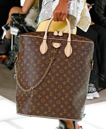 Canvas Carryall in Monogram Reverse with leather handles, $3,650, Louis Vuitton.