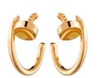 Juste un Clou yellow gold earrings, $3,650, Cartier.