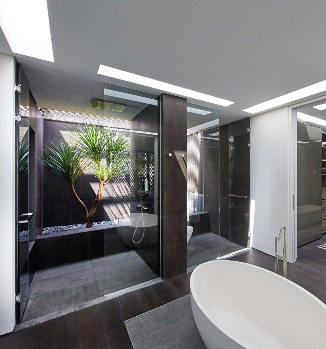 Carefully placed skylights in the master bathroom and walk-in wardrobe give the spaces a bright and airy feel.