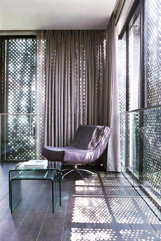 The perforated metal screens create an interesting pattern play that varies with the changing light conditions.