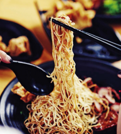 Everything in this bowl – from the noodles to the plump golden wonton, and the marinated roast meat – is made by Kelly.