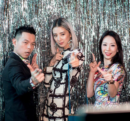 Adrian Ng and Loh May-Han with Irene Kim at the Instantly.sg photo booth