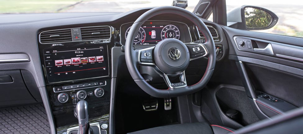 These Golf cockpits have identical amenities, but different niceties – racy red highlights for GTI (above), carbon-look inserts for R.