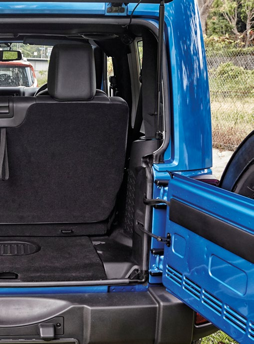 It's easier to open the Wrangler's tailgate in a forest clearing than in a multi-storey carpark.