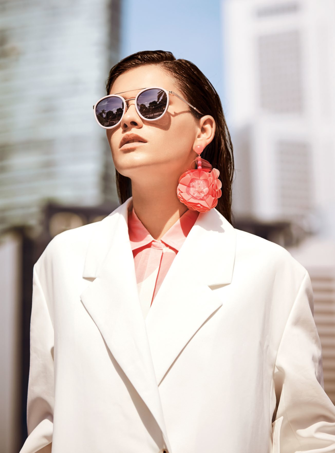 Coat, $275, from COS. Blouse; and earrings, $225, from Bimba Y Lola. Sunglasses from Polaroid.