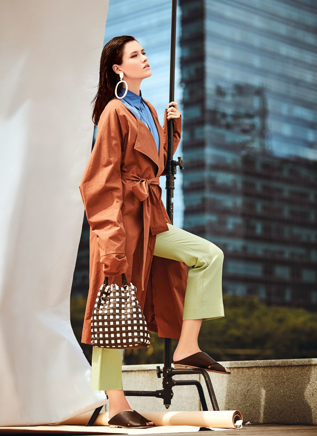 Coat, $275, from COS. Blouse and pants, both from Sandro. Earrings from Bimba Y Lola. Handbag, $785, from Furla. Sandals, $870, from Salvatore Ferragamo.