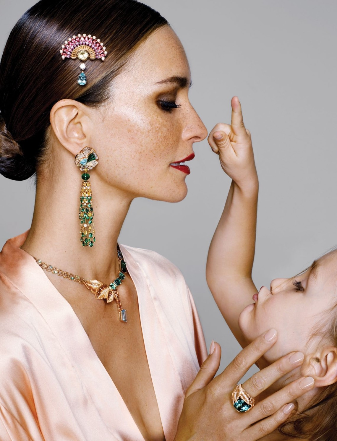Brooch (in hair); earring; necklace; ring, Piaget. Robe, La Perla