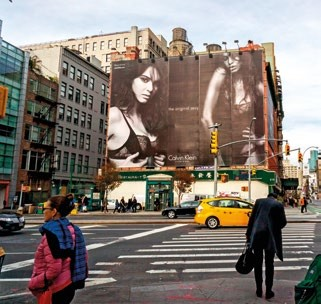 Kendall slays in her Calvins on a billboard  in NYC.